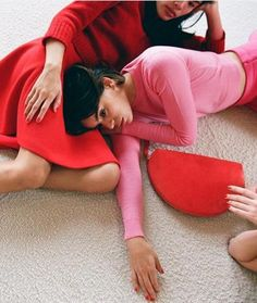 Cozy red sweater, knee-length full skirt in red, bubblegum pink cropped crew-neck sweater, pink high-waisted skit, pretty pink fingernail polish and a red leather half-moon clutch by Mansur Gavriel.