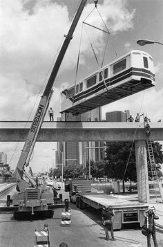 The first people mover train car is placed on its tracks.  June 19, 1985
