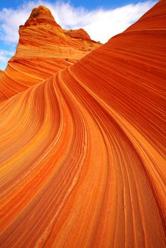 North Coyote Buttes - The Wave: Located on the Colorado Plateau near the Utah and Arizona border is a gallery of gruesomely twisted formations of sandstone resembling deformed pillars, cones, mushrooms and other odd creations. Deposits of iron claim some of the responsibility for the unique blending of color twisted in the rock, creating a dramatic rainbow of pastel yellows, pinks and reds.