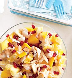 INGREDIENTS        1 large pineapple, cored and chopped      2 ripe mangoes, chopped      2 bananas, sliced      1/2 cup chopped canned lychees in syrup, drained      1/2 cup pomegranate seeds      3 tablespoons shredded sweetened dried coconu