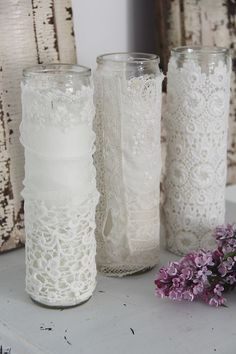 White holy candles.  Can be found at dollar stores usually for about $1.50.  Scentless.  Decorate with lace.