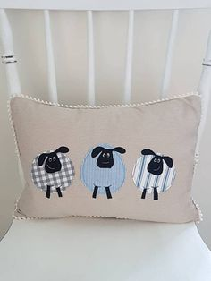 This lovely linen sheep cushion cover / linen sheep pillow cover would make a lovely gift for sheep lovers. This decorative cushion cover featuring three sheep is made using various cotton fabrics appliquéd onto a light beige linen background. Ive used free motion machine embroidery
