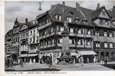 Zigarren Freytag 1920er    Nochmal ein Foto mit Bertoldsbrunnen. Im Hintergrund das schöne Fachwerkhaus des Traditiongeschäft Zigarren Freytag. 1920-30