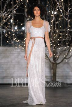 "Brides.com: Jenny Packham - Fall 2014. ""Freya"" beaded organza sheath wedding dress with a scoop neckline and sheer flutter short sleeves, Jenny Packham"