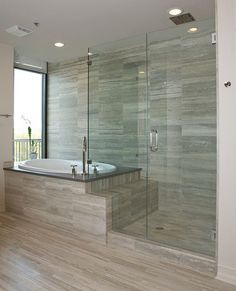 Gorgeous glass shower and garden tub