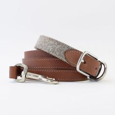 Handcrafted in England, this collar is made with wool tweed that is spun in Yorkshire, Bruccatio leather sourced from Italy, and nickel plated solid brass.