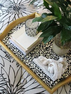 ikea tray spray painted gold with leopard print scrapbook paper glued to it