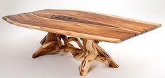 This marvelous dining table is made of twisted juniper logs artistically intertwined with a solid piece of exotic live with natural edges as the tabletop! The tabletop has live edges, but is soft to the touch. You can count the years this tree lived easily with the rings clearly visible. The legs are made of