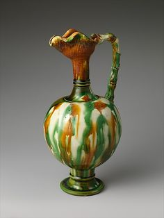Ewer Period: Tang dynasty (618–907) Date: late 7th century Culture: China Medium: Earthenware with three-color (sancai) glaze Dimensions: H. 11 1/8 in. (28.3 cm)