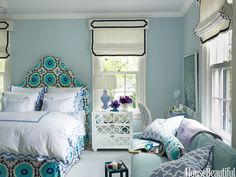 A bedroom with blue and purple. Design: Ashley Whittaker. housebeautiful.com. #bedroom #blue #purple #patterned_headboard