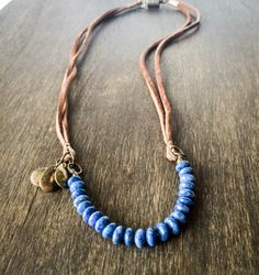 Blue Lapis Beaded Suede Leather Necklace, Bohemian Beaded Necklace, Tribal Leather Necklace, Rustic Necklace, Lapis Jewlery, Boho Chic by EsunaJewelry on Etsy https://www.etsy.com/listing/470838425/blue-lapis-beaded-suede-leather-necklace
