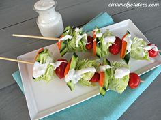 Salad On A Stick- Everything is more fun on a stick! Add any veggie you want and be sure to add some grilled chicken or other meat/fish of choice to get in some protein. Spritz with a light mist of vinaigrette, not ranch!