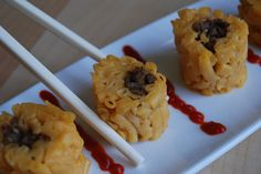 "Roll out mac & cheese, add ground beef, roll up and cut into ""sushi"" pieces"