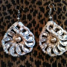 I recently bought these at The Yachting Center gift shop. They're made out of soda can tabs! Lightweight and stunning!