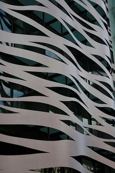 outer shell of building - top layer - transparent - structure beneath visible - hard material/soft pattern