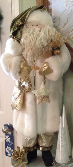 I made this Santa because my living room is decorated in white, gold and crystal.  I love how it turned out.