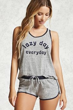 "A heathered knit PJ set complete with a tank featuring a ""Lazy Day Everyday"" front graphic, scoop neck, and contrast trim, as well as a pair of dolphin hem shorts with a matching contrast trim and elasticized drawstring waistband."