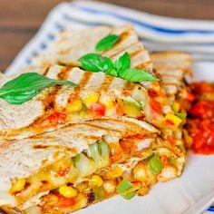Shrimp Fiesta Quesadillas Recipe Appetizers, Main Dishes with tortillas, mozzarella cheese, shrimp, tex mex seasoning, onion, green bell pepper, red bell pepper, butter, frozen corn