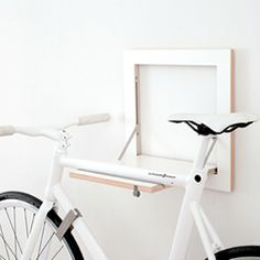 When open, SLÎT is a stable holder for your bike. When closed, SLÎT withdraws so discreetly that it practically becomes one with the wall.