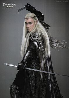 HOW IS LOOSE LONG HAIR, A HIGH COLLAR LONG SLEEVE MAXI DRESS, STUFFY METAL ARMOR, AND A FREAKING CAPE CONDUCIVE TO THRANDUIL'S SWORDFIGHTING STYLE?? HOW??