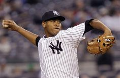 GAME 29: Tuesday, May 8, 2012 - New York Yankees starting pitcher Ivan Nova winds up in the first inning against the Tampa Bay Rays during their baseball game at Yankee Stadium in New York. (AP Photo/Kathy Willens)