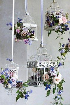 Bird cages, imagine them with all pink roses and white ribbons.