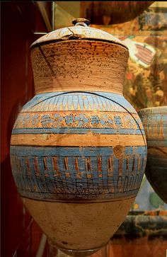 Blue painted terracotta jar decorated with flowers and grapes, and a jar lid. - Tell el-Amarna. Ashmolean Museum, Oxford