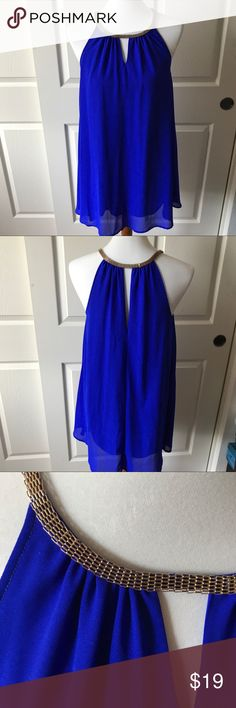 Royal Blue Trapeze Dress with Gold Beaded Neckline NWOT trapeze dress. 100% Polyester with lining. Hits right above the knee. Dresses