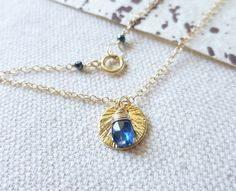 "Blue Kyanite Gold Disc Charm Necklace by KatKDesigns on Etsy, $28.00  Repin any pin on my ""Jewelry I created"" board and receive a 15% off coupon code to use on any item. Just send me a convo through Etsy with a link to the repin to receive the coupon code."