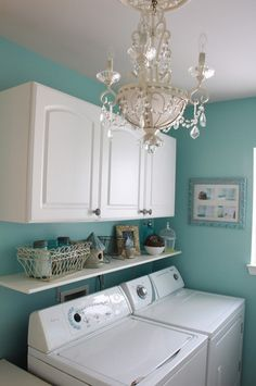 Laundry Room Layout- love the cabinets, the color of the walls, the shelf, everything about this laundry room!  And it would work perfectly in our space! I'd replace the fancy smancy chandelier with a rustic, old one to match our Decor though.  I don't like the fancy smancy chandelier either.
