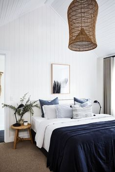 Palm print, indigo linen and rattan lights.