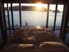 Waking up to the sun's reflection bouncing off the water in front of our bedroom full length window?  Yes, please!