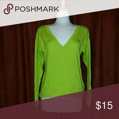 Lime Green Hollister V-Neck Sweater Great condition. Only worn 1 to 2 times. A little oversized, so could fit a medium to large. Hollister Sweaters V-Necks