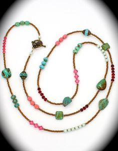 Long beaded necklace with natural turquoise.
