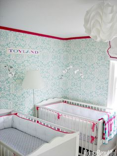 """""""The bedrooms in our old house are rather small, so it was a challenge to make enough space for my twin baby girls. I think the punch-and-aqua color scheme is chic but, above all, happy and fun."""" —Christina Sullivan Roughan, Interior Designer"""