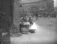 Earning a crust: A young peanut seller captured at work. A curious photo archivist from Newcastle stumbled on an amazing treasure trove of street photographs which capture the city's Victorian residents going about their daily lives.      Read more: http://www.dailymail.co.uk/news/article-2122864/Pictures-times-past-Photographs-discovered-abandoned-box-fascinating-insight-19th-Century-city-life-Britain.html#ixzz1qiuwYc7P