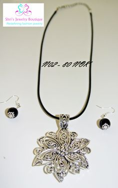 Elegant oxidized flower pendant with black elastic and with earring. Code no : N02 Price : 80 KR Status:SOLD