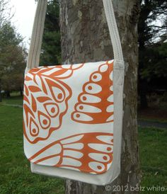 Transform a plain canvas tote into a snazzy messenger bag.