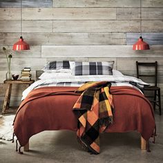Bringing the Wilderness trend into your bedroom. Combine lumberjack-check bedlinen in neutral colours with a couple of supersoft, chunky throws in rust, burnt orange or ochre tones.