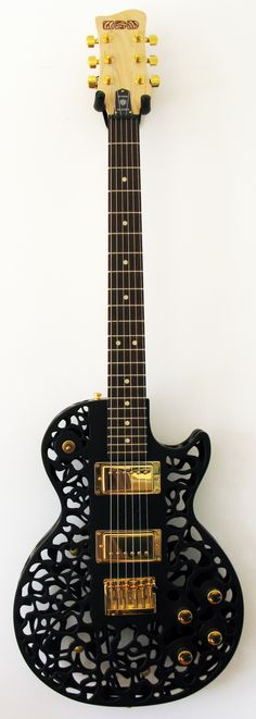 Atom 3D printed electric guitar: Inspired by patterns of oil spinning on water, or electrons. RESEARCH #DdO:) - https://www.pinterest.com/DianaDeeOsborne/instruments-for-joy/ - Price:  $3,500 w case. Body with added maple neck is printed using Selective Laser Sintering, by 3D Systems in the USA, on an sPro 230 SLS system. Material = Duraform PA- a very strong form of Nylon. 0.1mm layers make body. Mahogany or Maple inner core.  Dyed to choice colors & sprayed with clear satin finish. 22…