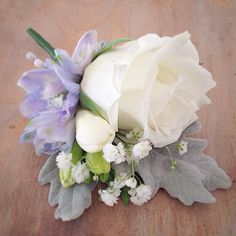 White rose buttonhole with touches of soft blue Delphinium, so pretty.