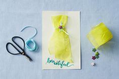 For the Mom Who Is Always Best Dressed - Homemade Mother's Day Cards That She's Going To Love - Southernliving. If you don't have the best penmanship, you should be able to find at the craft store clear stickers with a sentiment that best describes your mom. Gently tie a piece of thin string around a thicker ribbon to make the silhouette. Glue a tiny bead to the bow to give a pretty finish.
