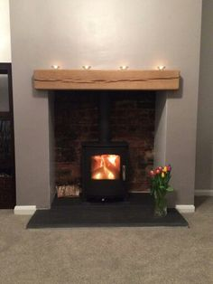 Mendip Churchill wood burning and multi fuel stove we installed in Bradford recently. We knocked out the customers chimney breast to reveal the original brick work at the back, supplied a slate hearth and oak beam. Contemporary Outdoor Fireplaces, Rustic Fireplaces, Home Living Room, Fireplace Built Ins, Fireplace Surrounds, Wood Fireplace, New Homes, Log Burner Living Room, Fireplace
