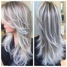 Long layered hair, greyish blonde color