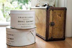 Antique hat boxes and a vellum suitcase