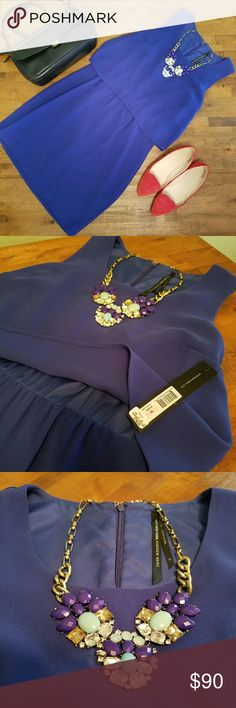 MARC NEW YORK ANDREW MARK Dress This dress is NWT. Never been worn and in perfect condition. Super cute! Could be worn to work or a wedding. The color is Royal. Andrew Marc Dresses Midi