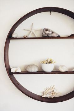 cute idea for a shelf - almost like a porthole! Beach house shelves.