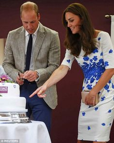 Catherine, Duchess of Cambridge and Prince William, Duke of Cambridge cut a 25th anniversary cake during their visit to Keech Hospice Care on August 24, 2016 in Luton, England.