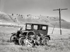 """July 1936. """"Vernon Evans and family of Lemmon, South Dakota, near Missoula, Montana, Highway 10. Leaving the grasshopper-ridden and drought-stricken area for a new start in Oregon and Washington. Make about 200 miles a day in Model T Ford."""" Our second glimpse of these travelers, last seen here. Medium-format negative by Arthur Rothstein, Resettlement Administration"""