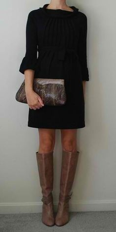 The dress is cute and simple with boots.  Will need tights in winter.  I like the neckline and rolled sleeves of this. -DK